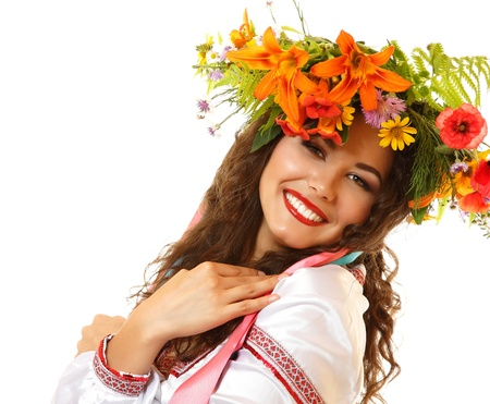 slavic: Beautiful ukrainian young woman in garland of summer flowers and native costume