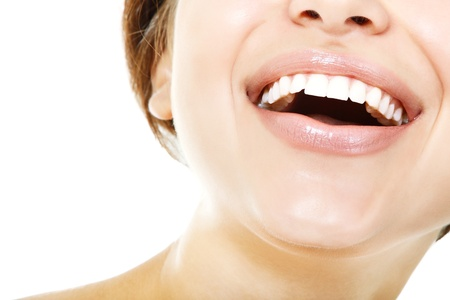 Beautiful smile of young fresh woman with great healthy white teeth over white background Stock Photo - 18628888
