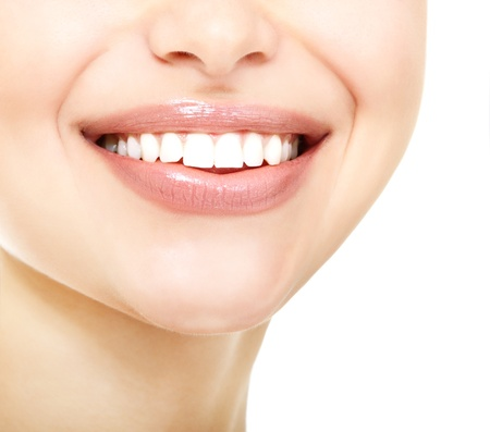 Beautiful smile of young fresh woman with great healthy white teeth over white background Stock Photo - 18628862