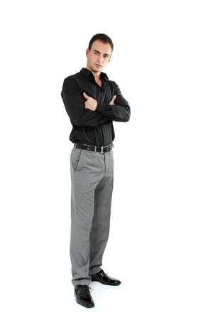 young male model: Young cheerful man in black shirt, full length portrait of attractive guy looking at camera over white background