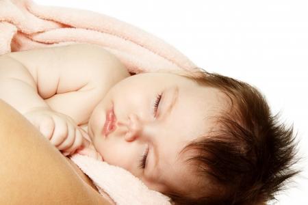 1 2 month: cute infant baby sleeping, beautiful kids face closeup, studio shot