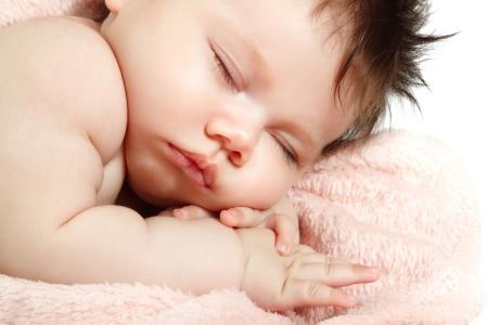 1 2 month: cute baby sleeping, beautiful kids face closeup, studio shot