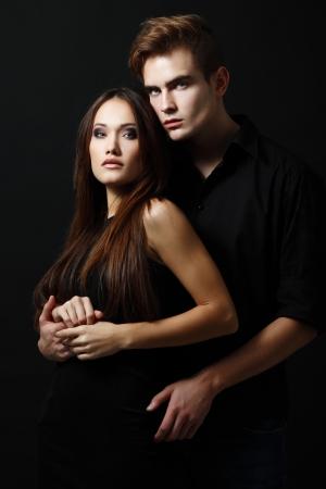 elegance fashion girls look sensuality young: Sexy passion couple, beautiful young man and woman closeup, studio shot Stock Photo
