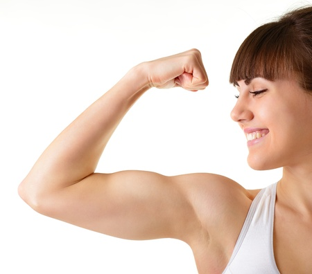 bicep: sport young woman with perfect body showing bicepses, fitness girl studio shot over white background