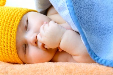 1 2 month: cute sleeping baby boy, beautiful infant face closeup, studio shot