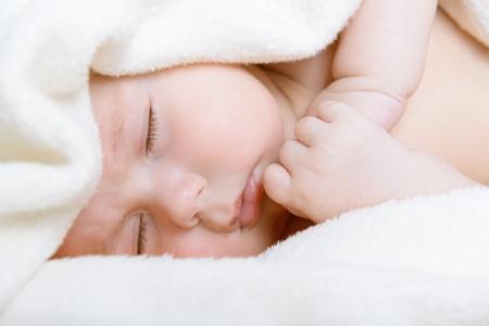 1 2 month: cute sleeping baby boy, beautiful kids face closeup, studio shot Stock Photo