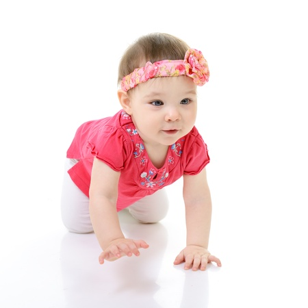 crawl: full legth portrait of cute happy smiling crawling little girl toddler, 10 month, studio over white