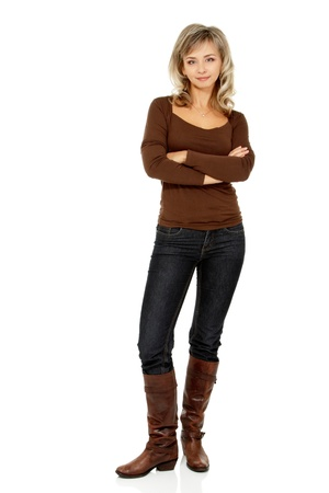 smiing: mid adult smiling woman portrait, attractive caucasian middle 40 years old woman in brown sweater, jeans and high boots over white
