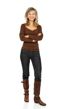 mid adult smiling woman portrait, attractive caucasian middle 40 years old woman in brown sweater, jeans and high boots over white photo