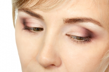 smiing: eyes makeup of mid adult woman over white Stock Photo