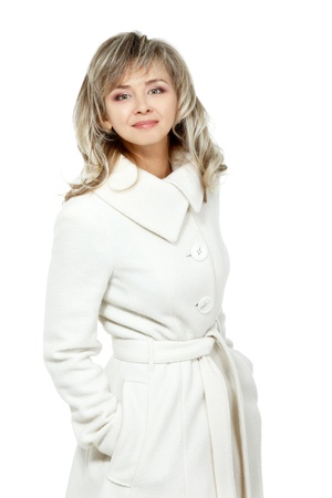 seasonal portrait of cheerful mid adult woman, attractive caucasian 40 years old woman in coat over white photo