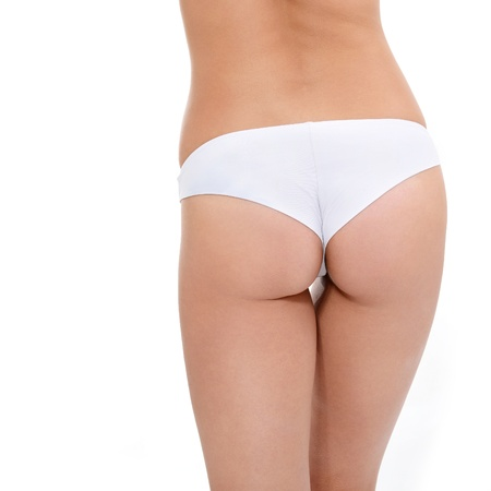 sexy woman panties: buttocks of young woman in underwear showing absence of cellulite over white background