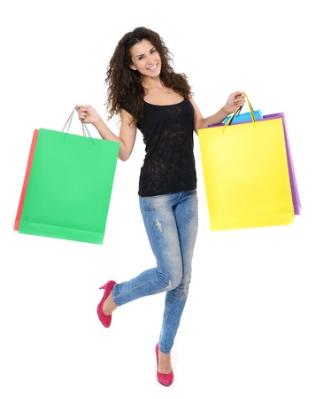 full length portrait of beautiful happy young woman with colored shopping sale bags over white Stock Photo - 19268885