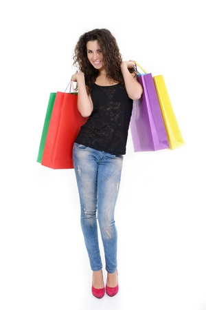 full length portrait of beautiful happy young woman with colored shopping sale bags over white Stock Photo - 19269550