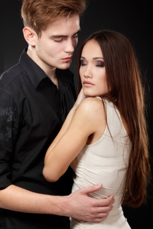 Sexy passion couple, beautiful young man and woman closeup, studio shot over black photo