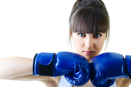 boxing training: sport young woman boxing gloves, face of fitness girl studio shot over white background