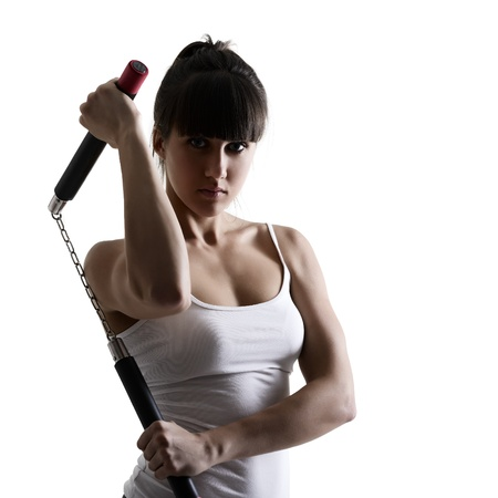 sport karate girl doing exercise with nunchaku, fitness woman silhouette studio shot over white background Stock Photo - 19364497