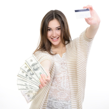 cash card: Cheerful attractive young lady holding cash with plastic card and happy smiling over white background Stock Photo