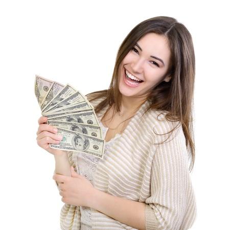 donna ricca: Allegro giovane donna attraente azienda contanti e felice sorridente su sfondo bianco