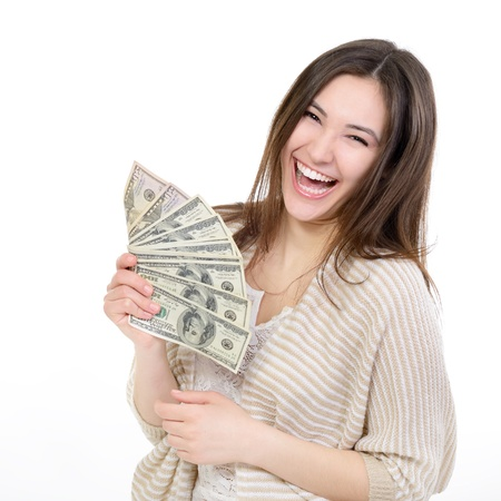 Cheerful attractive young lady holding cash and happy smiling over white background photo
