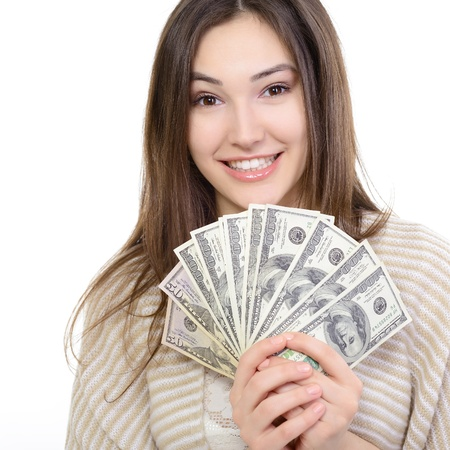 �cash: Cheerful attractive young lady holding cash and happy smiling over white