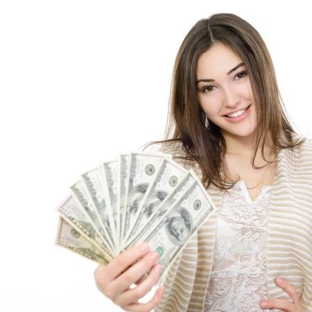 процветание: Веселые привлекательная молодая женщина с денежными средствами и счастливой улыбкой на белом фоне Фото со стока
