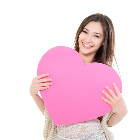 pink heart: portrait of attractive happy smiling teen girl with pink heart, love holiday valentine symbol over white background