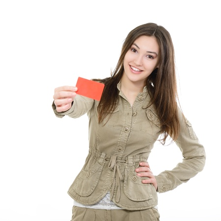 beautiful friendly smiling confident girl showing red card in hand, over white background photo