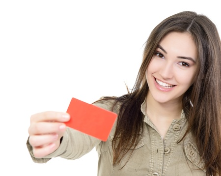 discount card: beautiful friendly smiling confident girl showing red card in hand, over white background