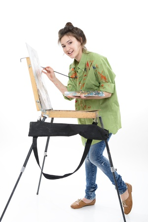 painter palette: teen girl painter drawing portrait with oil paints,  professional painter at work over white bacground