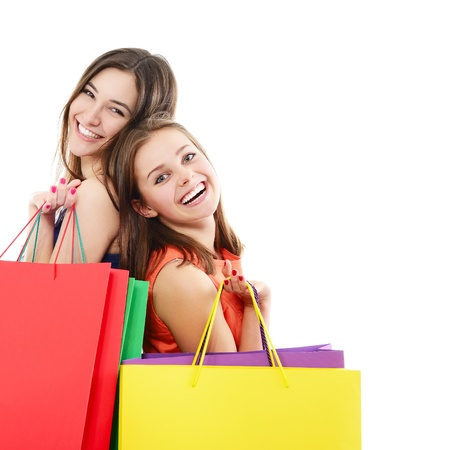 beautiful happy teen girls with colored shopping sale bags over white photo