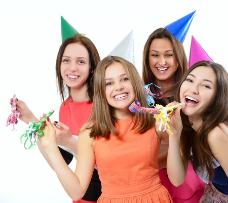 hedonistic: Joyful teen girls have fun on birthday party, over white