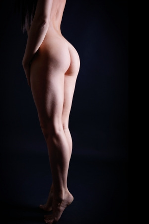 nude woman back: perfect body of young fitness woman, back and buttocks of sport girl, studio shot over black background