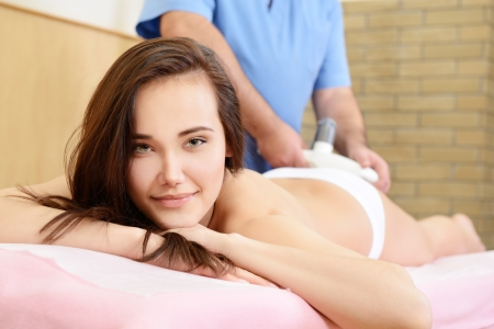 young beautiful woman getting anticellulite and anti fat therapy in beauty salon Stock Photo - 19422218
