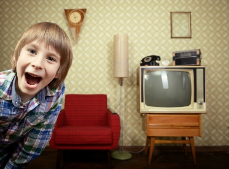 old television: vintage art portrait of liitle boy looking out at camera in room with interior from 70s, retro stylization, toned