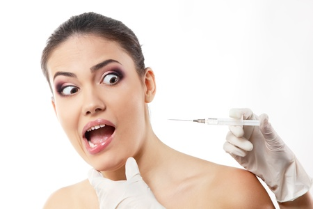 injection woman: emotional young woman afraids of syringe, beauty treatment theme, isolated on white