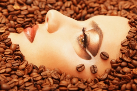 beautiful woman face in coffee  photo