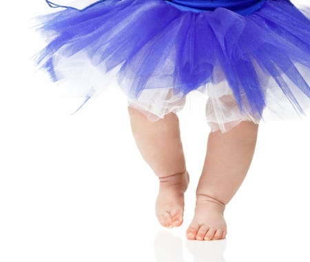 baby girl like a ballet dancer in blue tutu, isolated on white background photo