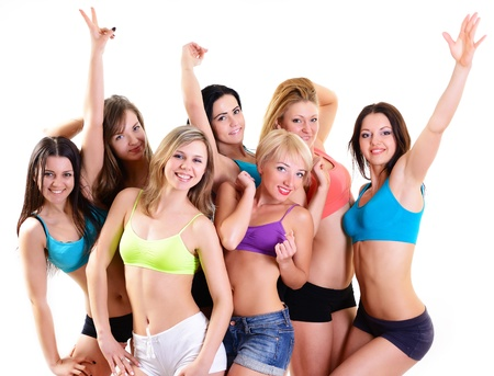 group of happy fitness young women have fun and smiling, over white background photo