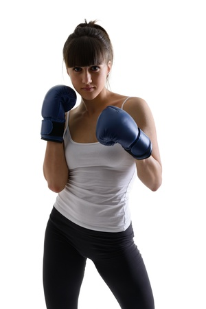 sport girl doing with exercise with boxing gloves, fitness woman studio shot in silhouette technique over white background photo
