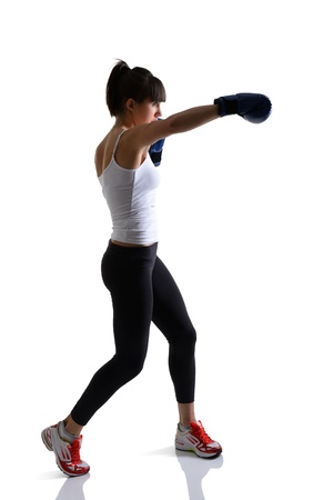 sport girl doing with exercise with boxing gloves, fitness woman studio shot in silhouette technique over white background