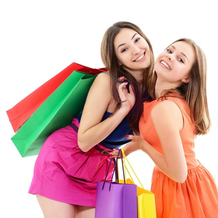 carrying girl: beautiful happy teen girls with colored shopping sale bags over white Stock Photo