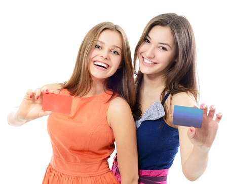 beautiful friendly smiling confident young women showing club cards in hands, over white background photo