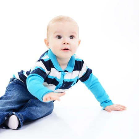 10 month: full legth portrait of cute happy smiling little boy toddler sitting in studio, 11 month, studio over white Stock Photo