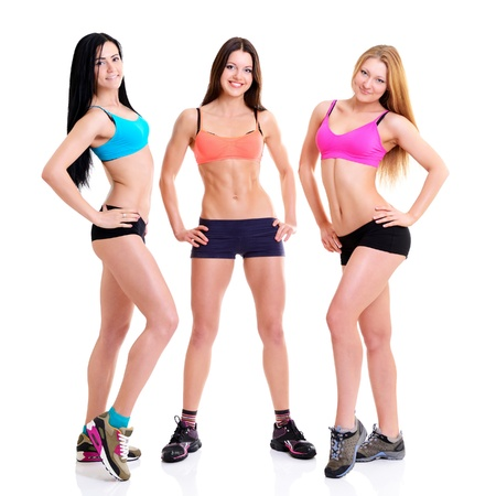 sportwear: Three Graces - fitness girls, portrait of sport young women with perfect bodies, studio shot over white Stock Photo