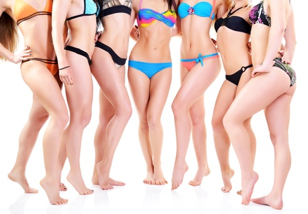 beachwear: group of girls in bikini, seven attractive caucasian young women in swimsuits over white Stock Photo