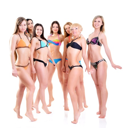 group of girls in bikini, seven attractive caucasian young women in swimsuits over white photo