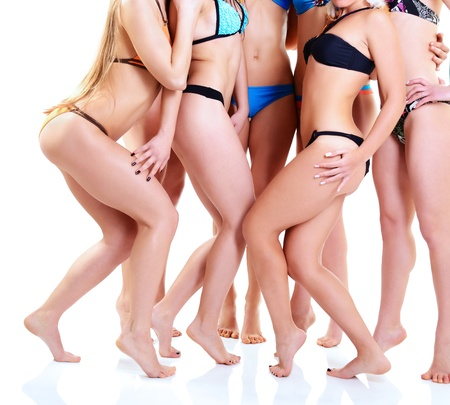 breech: girls in bikini with perfect fit bodies, seven attractive caucasian young women in swimsuits over white Stock Photo