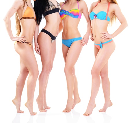group of women: girls in bikini, four attractive caucasian young women in swimsuits over white