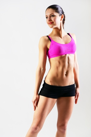 fitness girl, portrait sport young woman with perfect body, studio shot photo